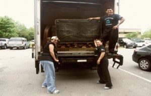 Team members from Cascades Village unload the truck at St.